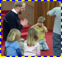 Uncle Steve Praying With Logos Kids